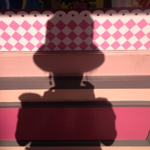 Shadow Self Portrait with Silver Hat outside candy shop at Universal